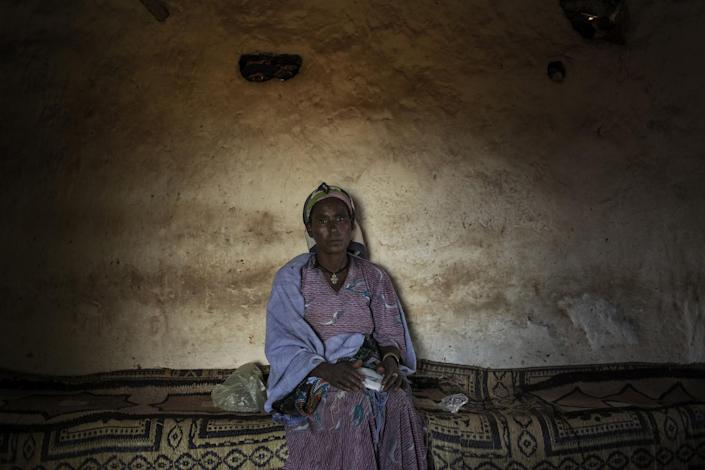 """Mesel Nigusie, a 48 years old women that has been circumcising girls for the last 28 years, poses in a house in Gindero, Amhara, Ethiopia. Since the Government prohibited it, female ablation is practiced in secret. """"I am still asked to do it, but it is not worth the risk when I don't make money out of it"""", she declares. """"Families prefer girls cut to marry their sons"""", she says. In Ethiopia, three of every four women between 15 and 49 have undergone (<em>female genital mutilation</em>) FGM in some form. (Photo: José Colón/MeMo)"""