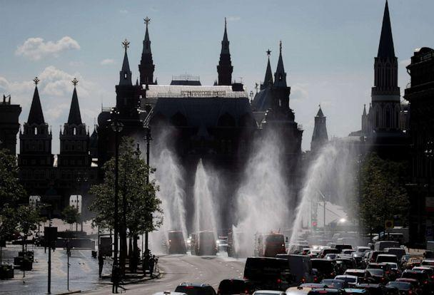 PHOTO: Vehicles spray disinfectant while sanitizing a road amid the novel coronavirus outbreak in Moscow, Russia, on May 28, 2020. (Maxim Shemetov/Reuters)