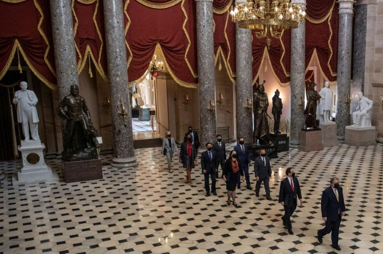 The House impeachment managers, pictured crossing the Capitol Rotunda on February 9, 2021, set up video screens and audio equipment in the Senate to show the graphic imagery and sounds of the deadly chaos from the January 6 attack on the US Capitol
