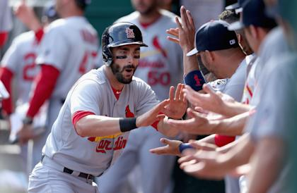 Matt Carpenter celebrates with teammates after hitting a home run on Sunday. (Getty)