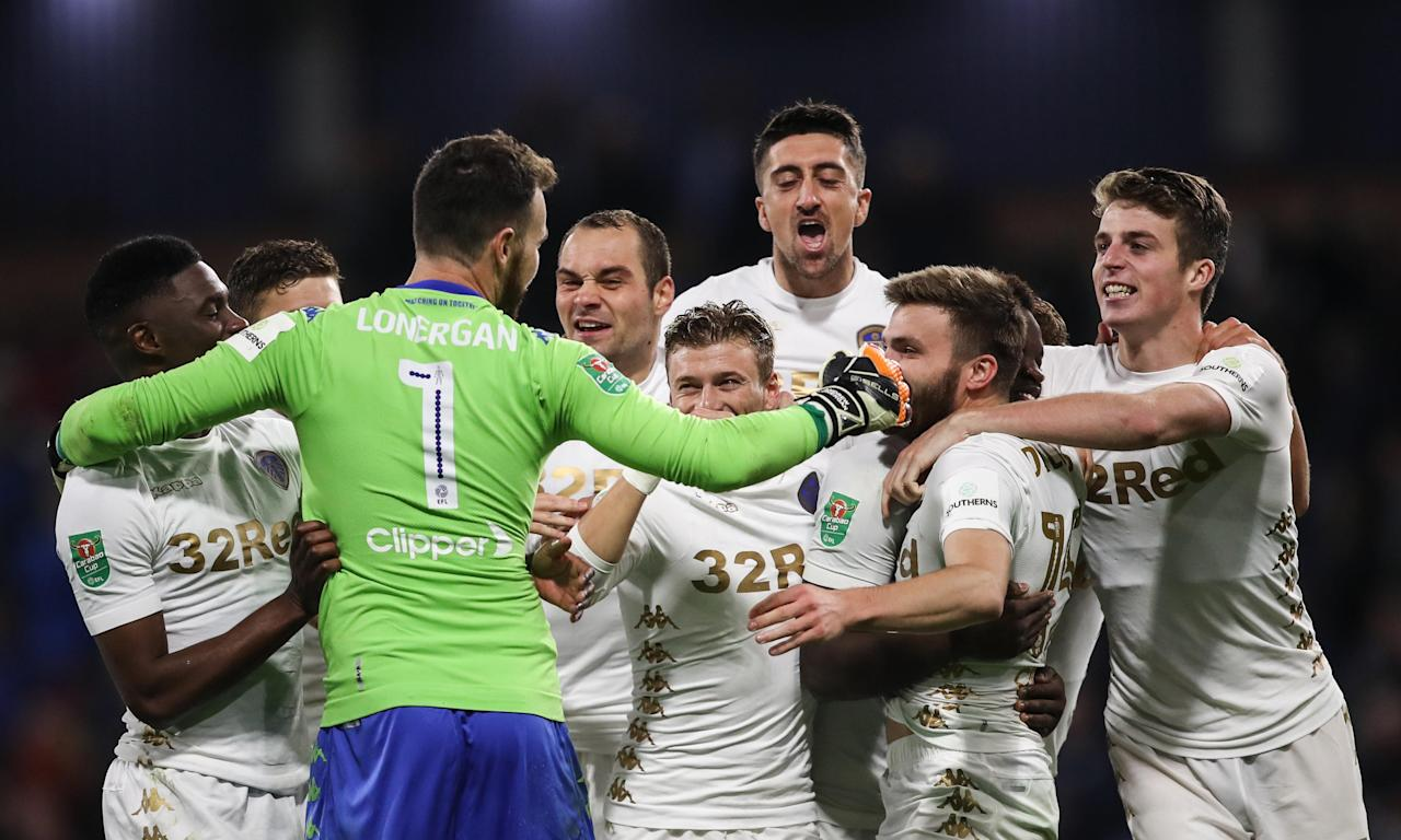 Andy Lonergan celebrates with his Leeds team-mates after his shootout save secured Carabao Cup victory.
