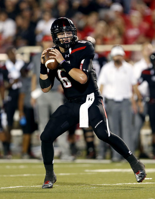 In this Saturday, Sept. 7, 2013, photo, Texas Tech's Baker Mayfield looks for their receiver during an NCAA college football game against Stephen F. Austin in Lubbock, Texas. Texas Tech's walk-on quarterback showed his scrambling and throwing talents in the Red Raiders first two games against lesser programs. But on Thursday night, Sept. 12, Texas Tech faces No. 24 TCU, which returns nine starters from the Big 12's top defense last season. (AP Photo/Lubbock Avalanche-Journal,Stephen Spillman)