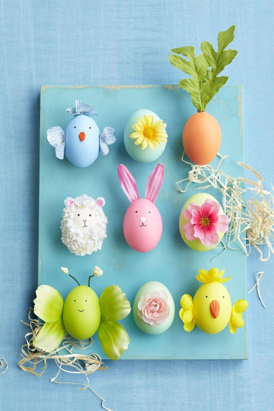"""<p>Craft your own herd of Easter characters by adhering faux flower petals, buds, and leaves to colored eggs. (Paint and decorate <a href=""""http://ceramiceggs.com/"""" rel=""""nofollow noopener"""" target=""""_blank"""" data-ylk=""""slk:ceramic eggs"""" class=""""link rapid-noclick-resp"""">ceramic eggs</a> and you can display this craft every spring!)</p><p><strong><em><a href=""""https://www.womansday.com/home/crafts-projects/how-to/a58121/how-to-make-lamb-egg/"""" rel=""""nofollow noopener"""" target=""""_blank"""" data-ylk=""""slk:Get the Easter Characters tutorial."""" class=""""link rapid-noclick-resp"""">Get the Easter Characters tutorial.</a></em></strong></p><p><strong><a class=""""link rapid-noclick-resp"""" href=""""https://www.amazon.com/Ceramic-Chicken-Nesting-Eggs-Brown/dp/B07662TMJD/?tag=syn-yahoo-20&ascsubtag=%5Bartid%7C10070.g.1751%5Bsrc%7Cyahoo-us"""" rel=""""nofollow noopener"""" target=""""_blank"""" data-ylk=""""slk:SHOP CERAMIC EGGS"""">SHOP CERAMIC EGGS</a></strong><br><br><strong>__________________________________________________________</strong><br><em><br></em></p><p><em>Want more Woman's Day? </em><a href=""""https://subscribe.hearstmags.com/subscribe/womansday/253396?source=wdy_edit_article"""" rel=""""nofollow noopener"""" target=""""_blank"""" data-ylk=""""slk:Subscribe to Woman's Day"""" class=""""link rapid-noclick-resp""""><em>Subscribe to Woman's Day</em></a><em> today and get </em><strong><em>73% off your first 12 issues</em></strong><em>. And while you're at it, </em><a href=""""https://link.womansday.com/join/3o9/wdy-newsletter"""" rel=""""nofollow noopener"""" target=""""_blank"""" data-ylk=""""slk:sign up for our FREE newsletter"""" class=""""link rapid-noclick-resp""""><em>sign up for our FREE newsletter</em></a><em> for even more of the Woman's Day content you want.</em><strong><br></strong><br></p>"""