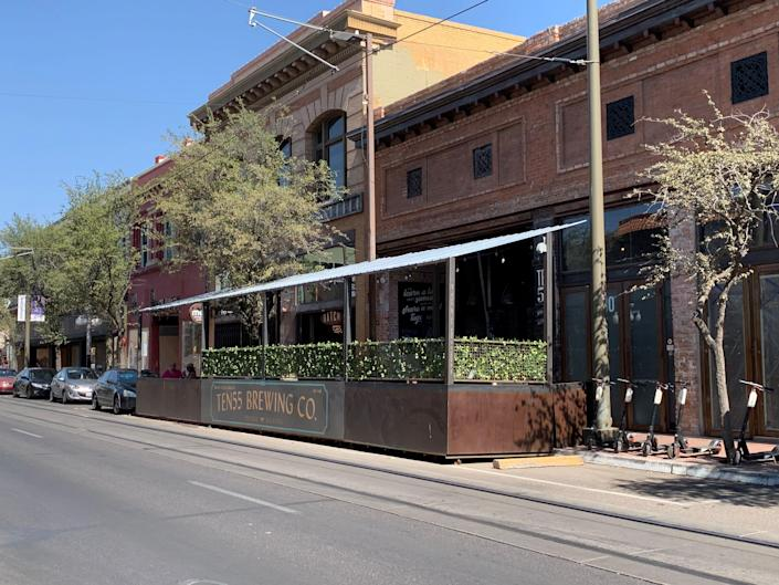 In Tucson, Arizona, restaurants and bars, including Ten55 Brewing, have built permanent structures for outdoor seating into on-street parking spots.