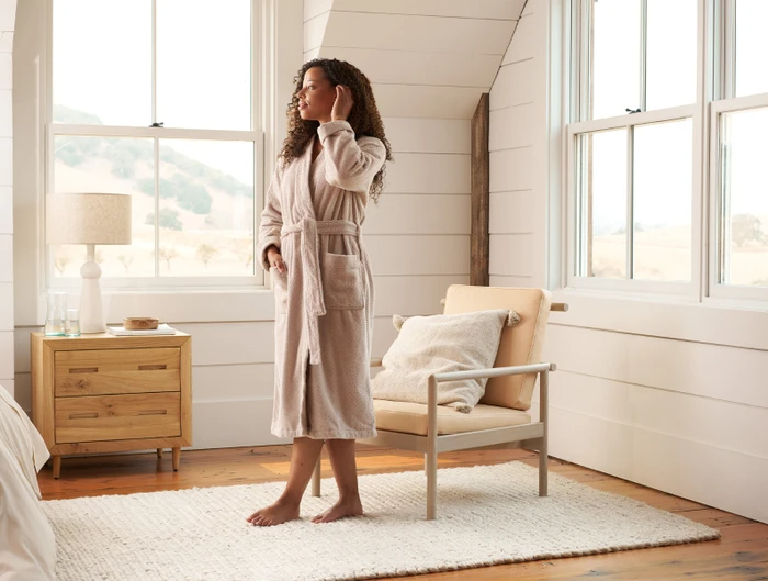 """<h3><h2>Coyuchi Air Weight Organic Robe</h2></h3><br>Coyuchi's newest robe is made with a slightly lighter version of their bestselling toweling material, is crafted from 100%, organic cotton, and designed to dry quickly on the hook or in the dryer. <br><br><strong>Coyuchi</strong> Unisex Air Weight® Organic Robe, $, available at <a href=""""https://go.skimresources.com/?id=30283X879131&url=https%3A%2F%2Fwww.coyuchi.com%2Funisex-air-weight-organic-robe.html"""" rel=""""nofollow noopener"""" target=""""_blank"""" data-ylk=""""slk:Coyuchi"""" class=""""link rapid-noclick-resp"""">Coyuchi</a>"""