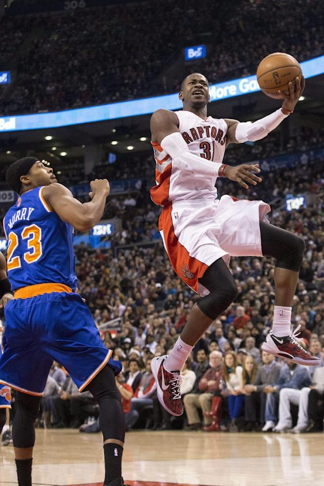Toronto Raptors' Terrence Ross goes to the basket past New York Knicks' Toure' Murry during the first half of an NBA basketball game in Toronto on Saturday, Dec. 28, 2013. (AP Photo/The Canadian Press, Chris Young)