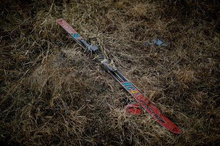 A Fischer ski lies in grass at the abandoned Alps Ski Resort located near the demilitarised zone separating the two Koreas in Goseong, South Korea, January 17, 2018. REUTERS/Kim Hong-Ji