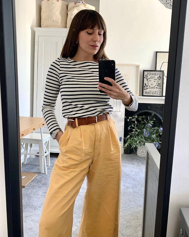 """<p><a href=""""https://www.elle.com/uk/fashion/what-to-wear/g21197401/best-breton-top/"""" rel=""""nofollow noopener"""" target=""""_blank"""" data-ylk=""""slk:Breton tops"""" class=""""link rapid-noclick-resp"""">Breton tops</a> are forever chic. Try wearing yours with a cinched belt and oversized trousers like Katherine Ormerod.</p><p><a class=""""link rapid-noclick-resp"""" href=""""https://www.shareasale-analytics.com/r.cfm?b=853610&u=314743&m=65303&afftrack=127X991729Xde3d33bd5d14ae00de496ec097a39858&urllink=www.saint-james.com%2Fgb%2Fbreton-clothing-classics%2Fbreton-striped-shirts%2Fminquiers-drop-striped-nautical-top-with-dropped-armholes.html&shrsl_analytics_sscid=41k5_f2hhr&shrsl_analytics_sstid=41k5_f2hhr"""" rel=""""nofollow noopener"""" target=""""_blank"""" data-ylk=""""slk:SHOP BRETON TOP NOW"""">SHOP BRETON TOP NOW</a></p><p><a href=""""https://www.instagram.com/p/CNVQJCGg3GT/"""" rel=""""nofollow noopener"""" target=""""_blank"""" data-ylk=""""slk:See the original post on Instagram"""" class=""""link rapid-noclick-resp"""">See the original post on Instagram</a></p>"""