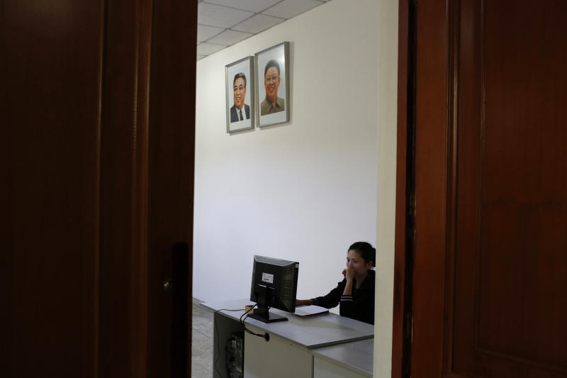 CAPTION CORRECTION, CORRECTS YEAR IN SECOND SENTENCE - FILE - In this Sept. 20, 2012 file photo, a North Korean woman sits in a computer room near portraits of the country's late leaders, Kim Il Sung and Kim Jong Il, at the Kim Chaek University of Technology in Pyongyang, North Korea. Google's executive chairman Eric Schmidt is preparing to travel to one of the last frontiers of cyberspace: North Korea. Schmidt will be traveling to North Korea on a private trip led by former New Mexico Gov. Bill Richardson that could take place as early as this month, sources told The Associated Press on Wednesday, Jan. 2, 2013. The sources, two people familiar with the group's plans, asked not to be named because the visit had not been made public. (AP Photo/Vincent Yu, File)