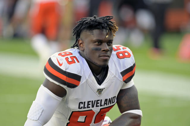 FILE - In this Aug. 8, 2019, file photo, Cleveland Browns tight end David Njoku kneels on the field before an NFL preseason football game against the Washington Redskins, in Cleveland. Njoku has returned to practice after missing eight games with a broken right wrist. Njoku was injured in Clevelands win over the New York Jets on Sept. 16. The Browns designated Njoku for return from injured reserve on Wednesday, Nov. 20, 2019. (AP Photo/David Richard, File)
