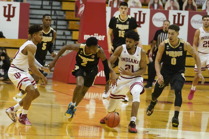 Purdue's Eric Hunter Jr. (2) and Indiana's Jerome Hunter (21) battle for the ball during the first half of an NCAA college basketball game, Thursday, Jan. 14, 2021, in Bloomington Ind. (AP Photo/Darron Cummings)