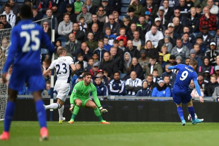 Leicester City's Jamie Vardy (R) scores opening goal during their English Premier League football match against West Bromwich Albion at The Hawthorns stadium in West Bromwich, central England, on April 29, 2017