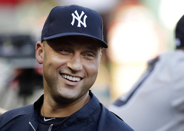 """FILE - In this July 22, 2013, file photo, New York Yankees shortstop Derek Jeter laughs while standing in the dugout with teammates during a baseball game against the Texas Rangers in Arlington, Texas. The New York Yankees superstar is forming his own imprint, Jeter Publishing, in partnership with Simon & Schuster. Simon & Schuster announced the imprint Thursday, Nov. 14, 2013, and said Jeter will draw upon his many friendships in the sports world and use the """"trust factor"""" to attract authors. (AP Photo/LM Otero, File)"""