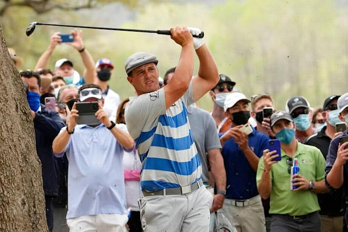 Bryson DeChambeau hits a shot near the trees on the 16th hole during a first round match at the Dell Technologies Match Play Championship golf tournament Wednesday, March 24, 2021, in Austin, Texas.
