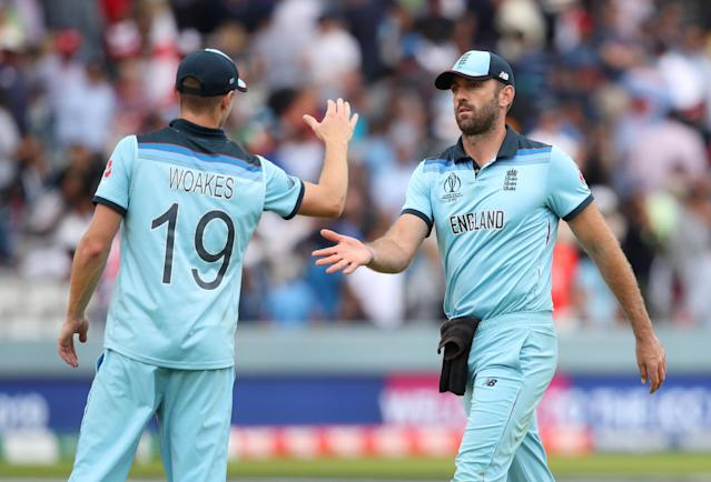 England's Chris Woakes shakes hands with Liam Plunkett after England's innings Action Images via Reuters/Peter Cziborra