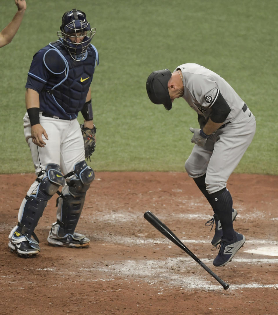 Tampa Bay Rays catcher Mike Zunino looks toward New York Yankees' Brett Gardner, right, after he was hit by a pitch from Tampa Bay reliever Josh Fleming during the seventh inning of a baseball game Tuesday, May 11, 2021, in St. Petersburg, Fla. (AP Photo/Steve Nesius)