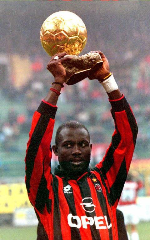 George Weah holding aloft the Ballon d'Or in 1996 when he played for AC Milan - Credit: CARLO FERRARO/AFP