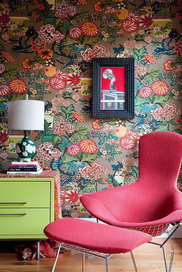 <p>If you don't have room for a whole library, you can create a one-of-a-kind reading space complete with vibrant wallpaper and colorful furniture.</p>