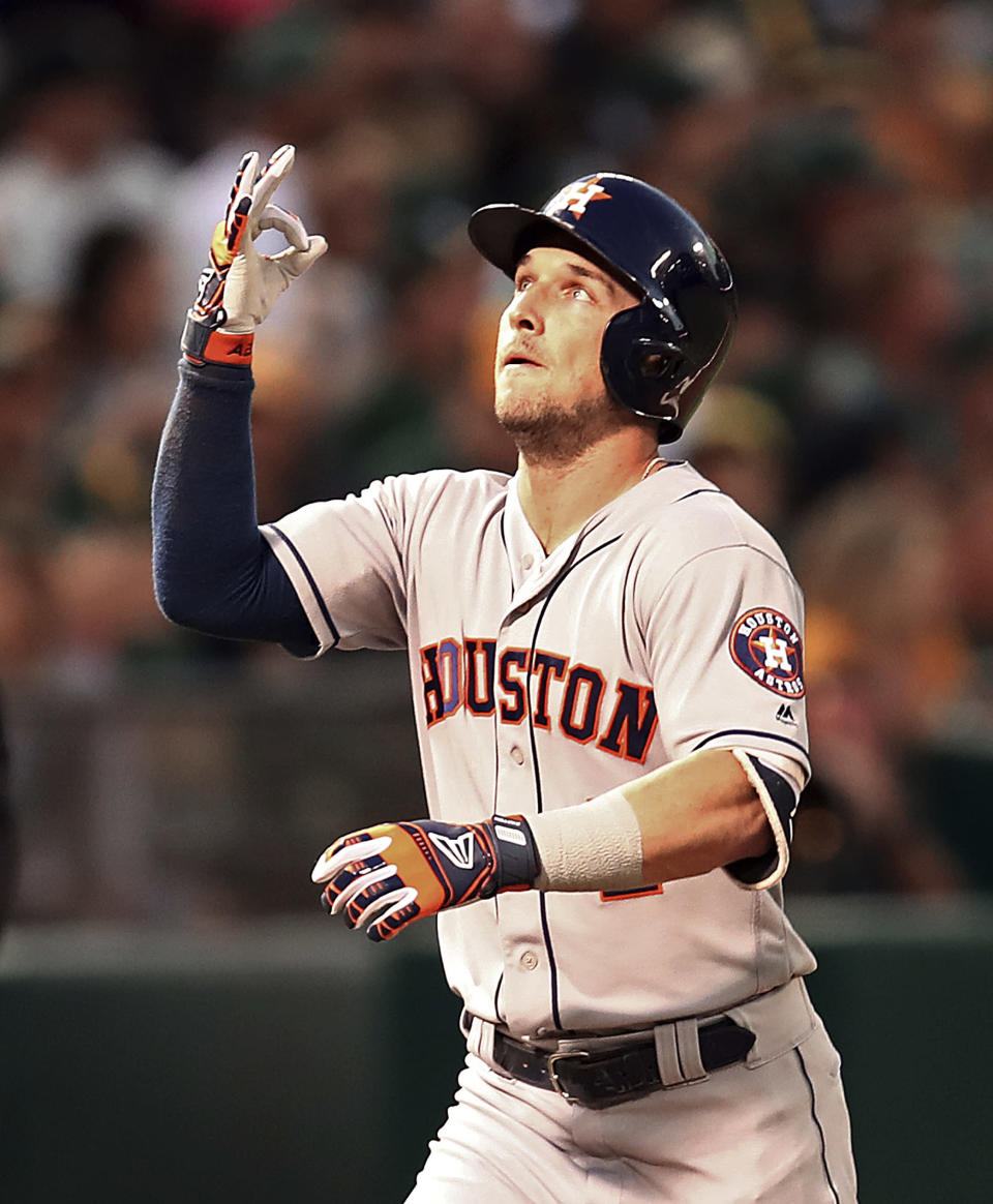 Houston Astros' Alex Bregman celebrates after hitting a home run off Oakland Athletics' Edwin Jackson in the fourth inning of a baseball game Friday, Aug. 17, 2018, in Oakland, Calif. (AP Photo/Ben Margot)