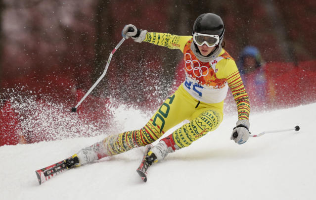 Togo's Alessia Afi Dipol makes a turn in the first run of the women's giant slalom at the Sochi 2014 Winter Olympics, Tuesday, Feb. 18, 2014, in Krasnaya Polyana, Russia. (AP Photo/Charles Krupa)