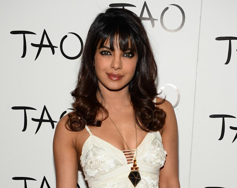 """FILE - In this August 10, 2013 file photo, Priyanka Chopra hosts the evening at TAO Las Vegas with DJ Vice, in Las Vegas. The Indian actress-singer, who sang the intro to last season's """"Thursday Night Kickoff,"""" will sing the intro to NFL Network's """"Thursday Night Football"""" this season. She replaces CeeLo Green. (AP Photo/TAO, Al Powers/Powers Imagery)"""