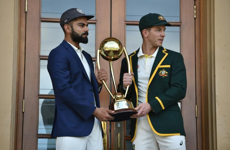 Australia cricket captain Tim Paine (right) and India cricket captain Virat Kohli (left) with the Border Gavaskar trophy ahead of the first Test at the Adelaide Oval in 2018