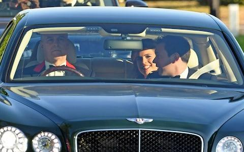 The Duke of York drives his daughters Princess Beatrice, Princess Eugenie and Eugenie's fiancee Jack Brooksbank to the venue in a Bentley - Credit: Steve Finn for The Telegraph