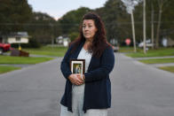 Natalie Walters, 53, holds a photo of her parents, Jack and Joey Walters, near her home in Syracuse, N.Y., Tuesday, Sept. 21, 2021. Walters' father, who was staying at the Loretto Health and Rehabilitation nursing home in Syracuse, died of COVID-19 in December 2020. The facility's staffing has declined during the pandemic and Walters wonders if poor staffing played a role in her father's infection or death. Nationwide, one-third of U.S. nursing homes have fewer nurses and aides than before COVID-19 began ravaging their facilities, an Associated Press analysis of federal data finds. (AP Photo/Heather Ainsworth)