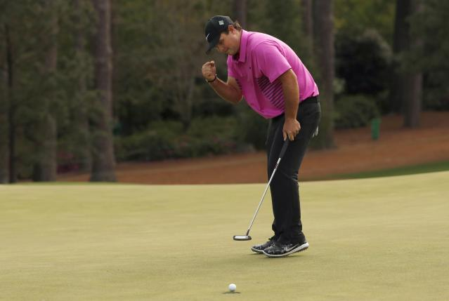 Patrick Reed of the U.S. makes a birdie putt on the 14th green during final round play of the 2018 Masters golf tournament at the Augusta National Golf Club in Augusta, Georgia, U.S. April 8, 2018. REUTERS/Jonathan Ernst