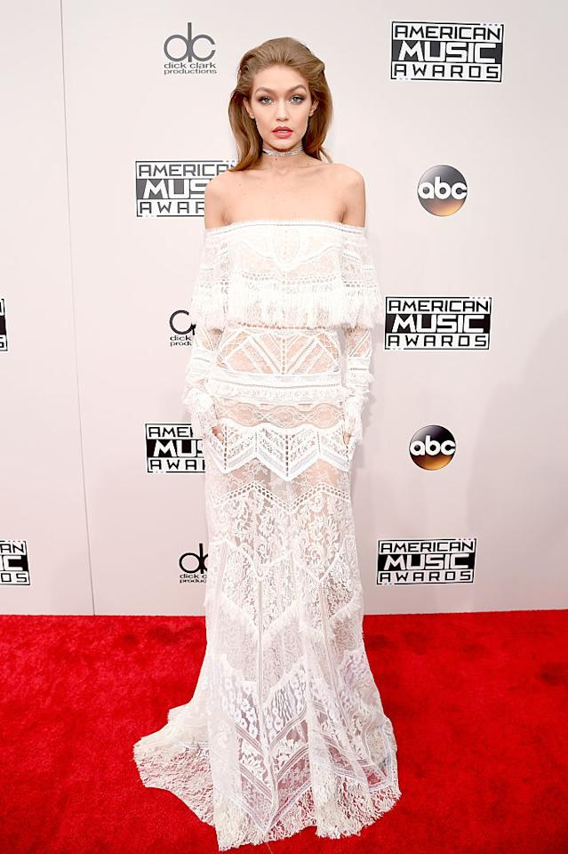 <p>On the red carpet, Gigi Hadid looked like a blushing bride ready to hit the beach and say 'I do.' The sheer Roberto Cavalli number featuring an off-the-shoulder silhouette that was paired with a sparkly choker necklace. She also had her hair slicked back and again painted on a bright red lip for maximum makeup impact. <em>(Photo: Getty Images)</em> </p>