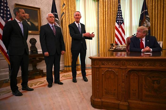 In the White House, officials including President Donald Trump and Vice President Mike Pence never wear masks, although they are frequently tested for coronavirus (AFP Photo/JIM WATSON)