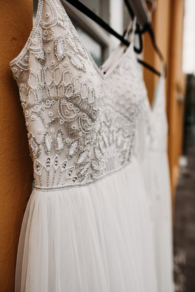 <p>Whether it's hanging in front of a window or from a bedpost, <em>the</em> dress deserves to be captured in its full glory. </p>