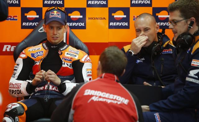 Repsol Honda Team's Australian rider Casey Stoner (L) chats with staff inside the pit during the Moto GP Training session of the Valencia Grand Prix at Ricardo Tormo racetrack in Cheste, on November 9, 2012. AFP PHOTO/ JOSE JORDANJOSE JORDAN/AFP/Getty Images