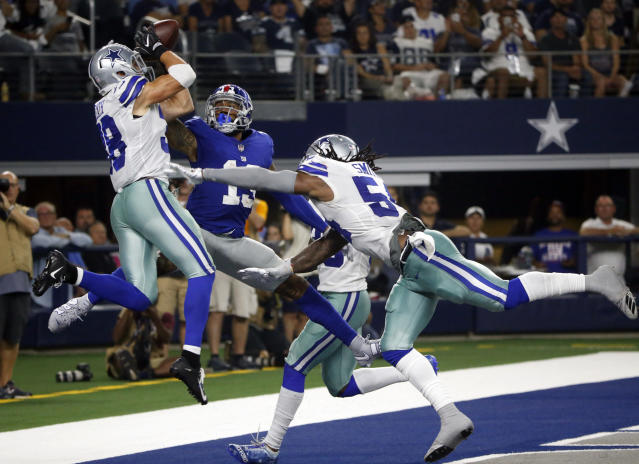 Dallas Cowboys defensive back Jeff Heath, left, breaks up a pass in the end zone intended for New York Giants wide receiver Odell Beckham (13) during the second half of an NFL football game in Arlington, Texas, Sunday, Sept. 16, 2018. (AP Photo/Michael Ainsworth)
