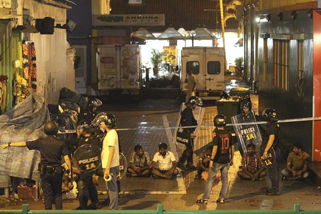 Police detain men following a riot in Singapore's Little India district, late December 8, 2013. (REUTERS/Dennis Thong/Lianhe Zaobao)
