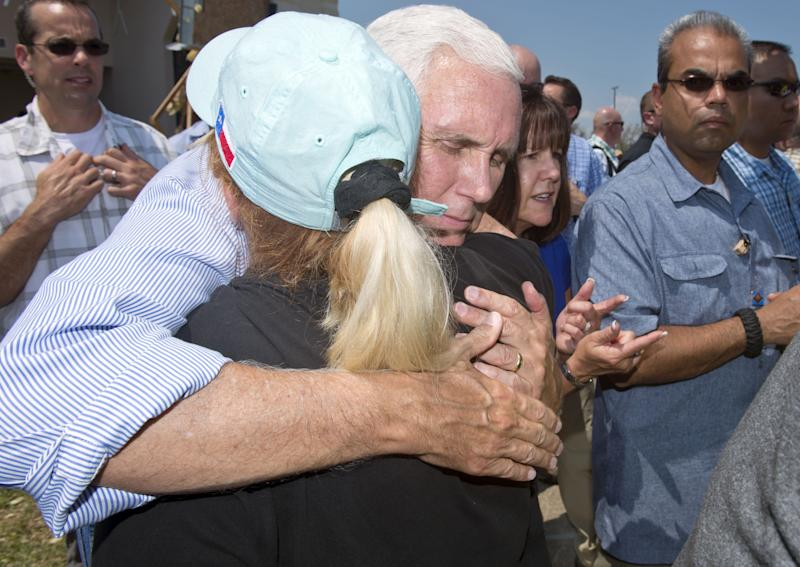 Vice President Mike Pence hugs a woman during a trip to survey the damage from Hurricane Harvey in Rockport, Texas, on Aug. 31. (Bloomberg via Getty Images)