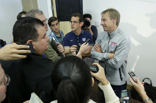 United States soccer coach Jurgen Klinsmann, right, speaks at a news conference for the World Cup soccer tournament in Stanford, Calif., Friday, May 23, 2014. (AP Photo/Jeff Chiu)