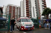 An ambulance carrying a migrant worker leaves Westlite Woodlands dormitory after workers were tested positive for the coronavirus disease (COVID-19), in Singapore