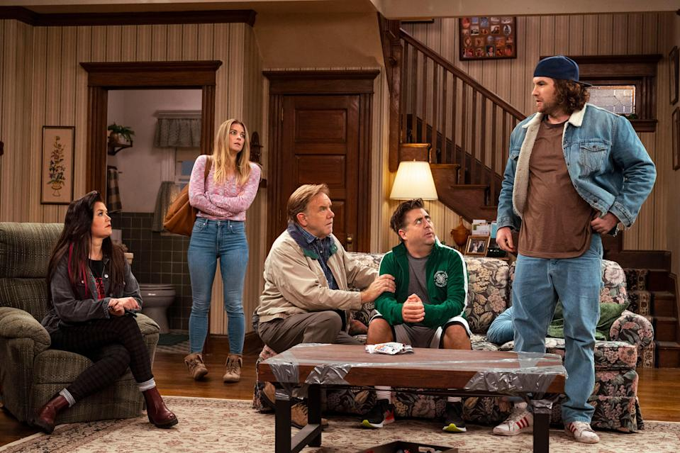 Mary Hollis Inboden as Patty, Annie Murphy as Allison, Eric Petersen as Kevin, Brian Howe as Pete, Alex Bonifer as Neil in a scene from the sitcom portion of Kevin Can F*** Himself.