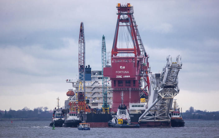 """FILE - In this Jan. 14, 2021, file photo, tugboats get into position on the Russian pipe-laying vessel """"Fortuna"""" in the port of Wismar, Germany. The special vessel is being used for construction work on the German-Russian Nord Stream 2 gas pipeline in the Baltic Sea. Pressure is growing on President Joe Biden to take action to prevent the completion of a Russian gas pipeline to Europe that many fear will give the Kremlin significant leverage over U.S. partners and allies. (Jens Buettner/dpa via AP)"""