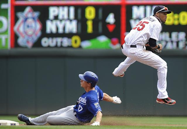 Minnesota Twins shortstop Pedro Florimon, right, jumps to avoid the slide of Kansas City Royals' Chris Getz, left, after getting the force at second on a double play during the fourth inning of a baseball game, Thursday, Aug. 29, 2013, in Minneapolis. (AP Photo/Tom Olmscheid)