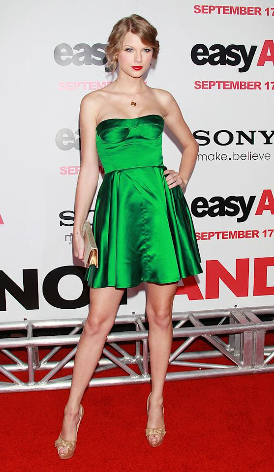 "She definitely bombed at the VMAs, but country cutie Taylor Swift rebounded on the red carpet at the premiere of ""Easy A"" in an emerald green Miu Miu bustier dress, bow-adorned heels, and soft curls. David Livingston/<a href=""http://www.gettyimages.com/"" target=""new"">GettyImages.com</a> - September 13, 2010"