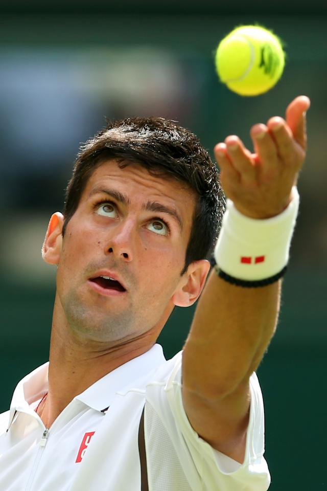 LONDON, ENGLAND - JUNE 25: Novak Djokovic of Serbia tosses the ball in the air before serving during his Gentlemen's Singles first round match against Florian Mayer of Germany on day two of the Wimbledon Lawn Tennis Championships at the All England Lawn Tennis and Croquet Club on June 25, 2013 in London, England. (Photo by Julian Finney/Getty Images)