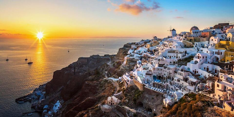 """<p> Santorini is considered to be the fairest island of them all. Visitors never tire of snapping photos of its whitewashed buildings with cobalt blue domes, swimming in its beautiful <a href=""""https://www.bestproducts.com/fun-things-to-do/news/a1736/black-sand-beaches-in-the-world/"""" rel=""""nofollow noopener"""" target=""""_blank"""" data-ylk=""""slk:black-sand beaches"""" class=""""link rapid-noclick-resp"""">black-sand beaches</a>, and gazing at the dreamy sunsets over the Aegean Sea. </p>"""