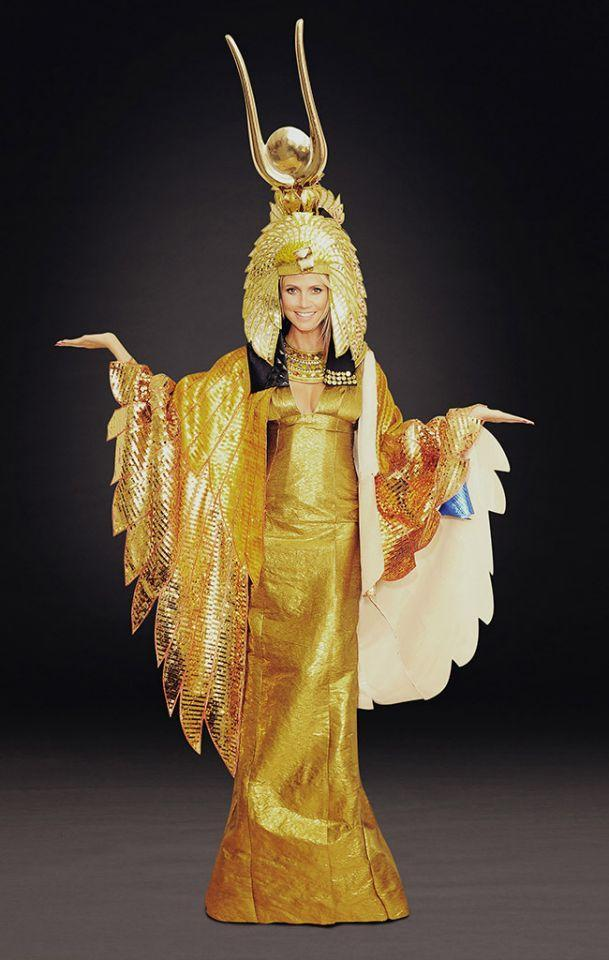 <p>No: 7: The mom of four waited a long time to wear this Cleopatra costume. Superstorm Sandy led her to cancel her annual soiree in 2012, but she vowed she would wear her costume — and she did, at a Haunted Holiday party in early December instead, with proceeds from the bash going to the Red Cross. It took several hours to get her makeup done for the royal ensemble because she had hundreds of stones individually glued to her face. Now that's dedication. (Photo: Michael Loccisano/Getty Images for Heidi Klum) </p>
