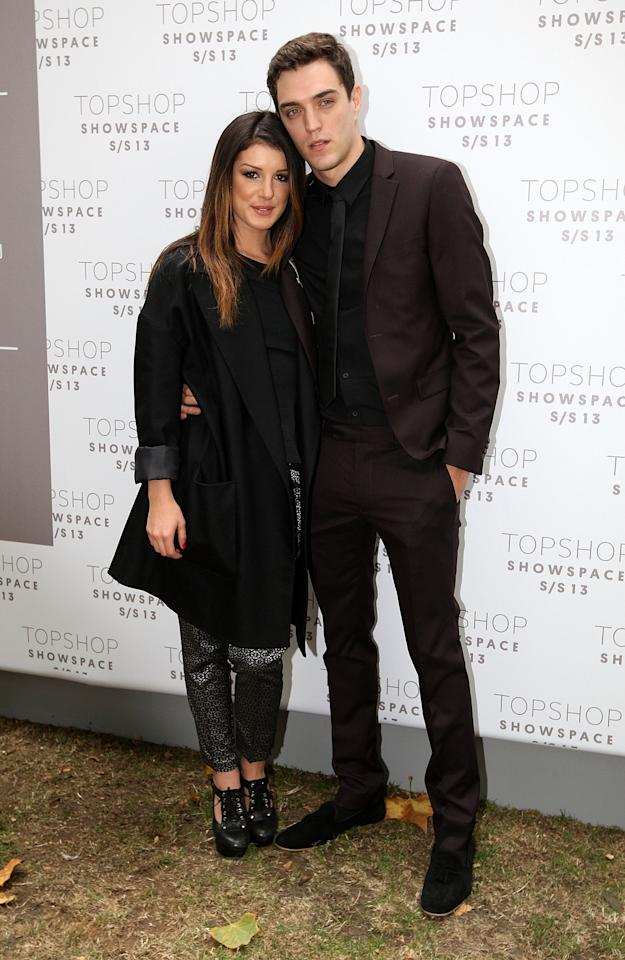 LONDON, ENGLAND - SEPTEMBER 16:  Shenae Grimes and Josh Beech attends the front row for the Unique show on day 3 of London Fashion Week Spring/Summer 2013, at The Topshop Venue on September 16, 2012 in London, England.  (Photo by Danny Martindale/WireImage)