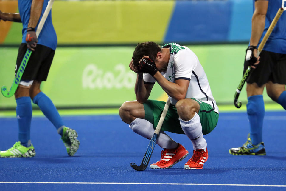<p>Ireland's Paul Gleghorne puts his hands to his head after losing to Argentina during a men's field hockey match at the 2016 Summer Olympics in Rio de Janeiro, Brazil, Friday, Aug. 12, 2016. (AP Photo/Dario Lopez-Mills) </p>
