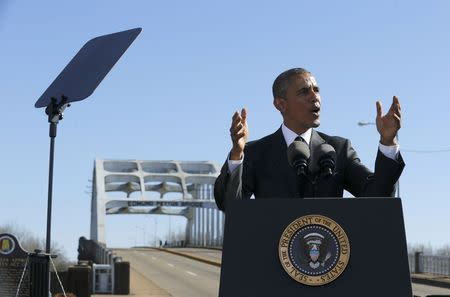 U.S. President Barack Obama delivers remarks at the Edmund Pettus Bridge in Selma, Alabama, March 7, 2015. REUTERS/Jonathan Ernst