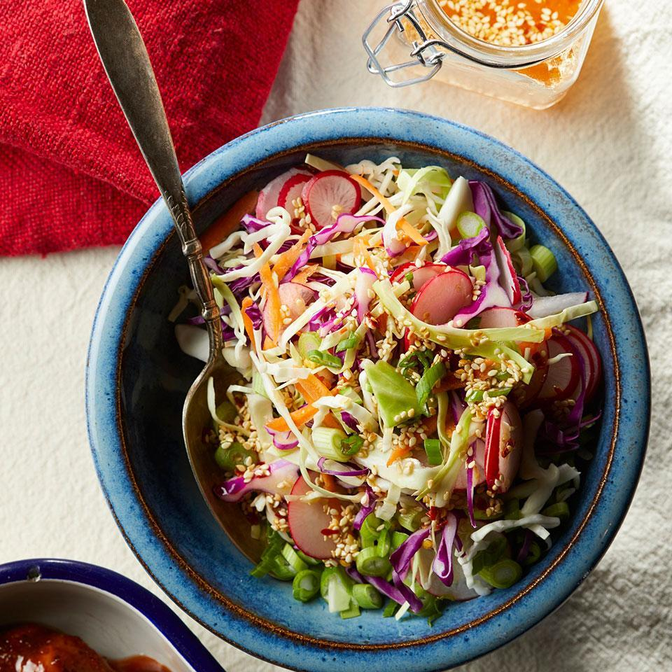 """<p>Sliced radishes add a peppery kick to this 10-minute slaw, which can serve as both a side and a topping for sandwiches. <a href=""""http://www.eatingwell.com/recipe/267219/spicy-cabbage-slaw/"""" rel=""""nofollow noopener"""" target=""""_blank"""" data-ylk=""""slk:View recipe"""" class=""""link rapid-noclick-resp""""> View recipe </a></p>"""