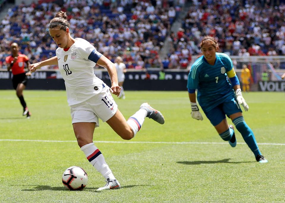 HARRISON, NEW JERSEY - MAY 26:  Carli Lloyd #10 of the United States catches Cecilia Santiago #1 of Mexico out of position in the second half at Red Bull Arena on May 26, 2019 in Harrison, New Jersey. (Photo by Elsa/Getty Images)